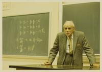 Columbia, South Carolina. Paul Dirac at blackboard; with notes on laboratory table