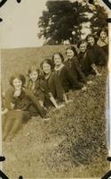 Eight Women Sitting in a Line