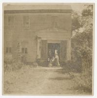 Family posing in front of Pine Hill Plantation