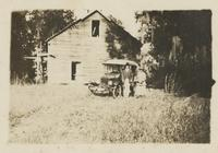 Couple posing in front of car at Pine Hill Plantation