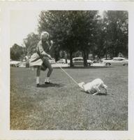 F Club Member in Costume Pulling Goat