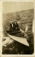 Couple Being Towed in a Rowboat