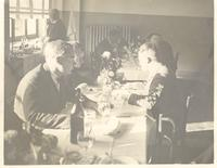 Brussels. Paul Dirac and others sitting at a table. Solvay Conference