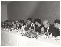 Austin. Paul Dirac and Manci seated at head dining table