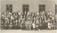 Copenhagen. Formal portrait at Commemorative Meeting for Neils Bohr of Paul Dirac and other attendees along with family of Bohr