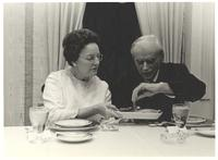 Coral Gables, Florida. Paul Dirac plating his meal with the help of an unidentified woman