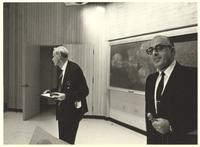 Coral Gables, Florida. Paul Dirac holding a medal and certificate at the front of a lecture hall