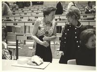 Coral Gables, Florida. Margit Dirac speaking with a woman in a lecture hall after an event ends
