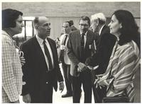 Coral Gables, Florida. Paul Dirac speaking with a man at a gathering