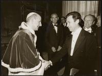 Vatican City. Pope John XXIII shaking hands with unidentified man
