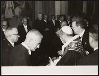 Vatican City. Unidentified men greeting the Pope