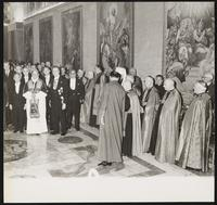 Vatican City. Right half of congregation standing with Pope John XXIII