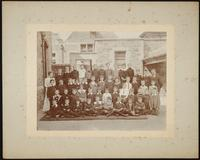 Bristol. Bishop Road School. Group portrait of male pupils and a female and male teachers
