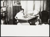 Budapest, Hungary. Unidentified man at desk