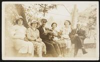 Charles Dirac and Florence Dirac sitting outside with others