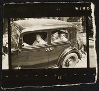 Budapest, Hungary. Margit Dirac and two children inside a car