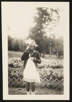 Balatonföldvár, Hungary. Unidentified girl in dress posing for a photo as the wind blows