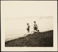 Balatonföldvár, Hungary. A woman sunbathing at Lake Balaton as two children stand of the shore