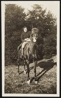 Washington. Betty Dirac riding a horse