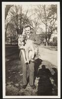 Washington. Paul Dirac holding his dog Wolk