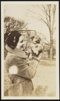 Washington. Betty Dirac holding Wolk as a puppy