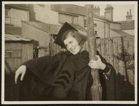 Cambridge. Unidentified young woman in a graduation cap and gown