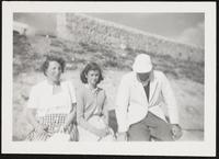 Cornwall. Margit and Paul Dirac with one of their daughters sitting outside in the sun