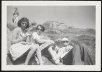 Cornwall. Margit and Paul with one of their daughters sitting outside in the sun