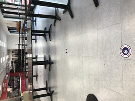 6 feet apart floor decals at Subway on FSU main campus