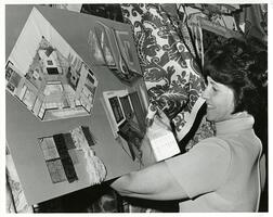 woman working with swatches for a room design model