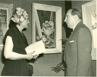 Claude and Mildred Pepper viewing Josephine Black's oil painting