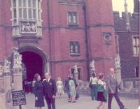 Claude and Mildred Pepper standing in front of Hampton Court Palace
