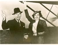 Claude and Mildred Pepper waving before boarding a plane and leaving on their honeymoon