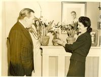 Claude and Mildred Pepper looking at flowers