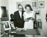 Claude and Mildred Pepper examining a plaque