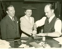 Claude and Mildred Pepper being finger-printed during War World II