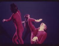Three dancers in red costumes
