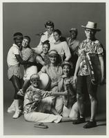 Group of costumed dancers posing