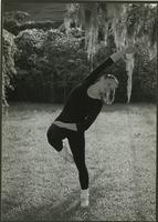 Janet Hughes practices under a tree