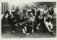 Group of dancers pose outside theatre