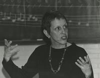 Nancy Smith teaches in front of chalkboard