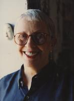 Nancy Smith smiles with glasses