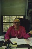 Nancy Smith at desk
