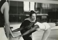 Lynda Davis helping student in studio