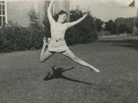 Woman leaping outside