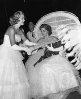 Lynn La Grange Prepares to Crown Queen Arielou Johnson, 1958