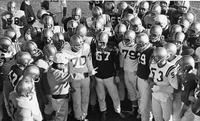 Football Team Meeting at Practice, 1963