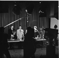 Two Men and Two Women on Television with Lamps