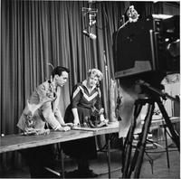 Man and Woman with Lamps on Camera