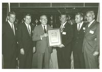 Claude Pepper and a small group holding a Governor's Award plaque